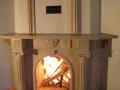 Резной портал углового камина из мраморра