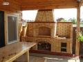 Барбекю пристроенный к веранде дома