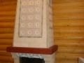 Камин с отделкой изразцами и плиткой