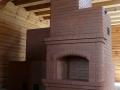 Печь камин из кирпича с лежанкой